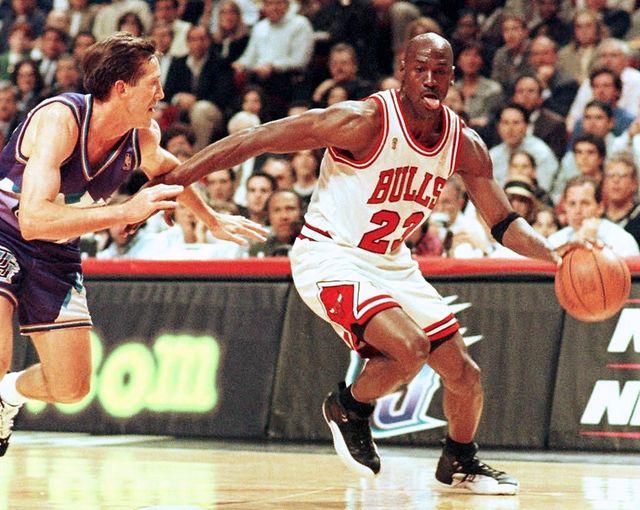 chicago bulls player michael jordan sticks out his