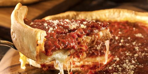 A slice of the chicago style deep dish cheese pizza