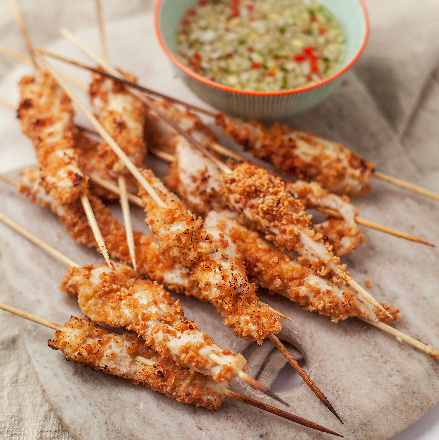 Peanut chicken skewers and chilli dip