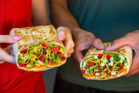 Food, Cuisine, Dish, Fast food, Sandwich wrap, Ingredient, Hand, Flatbread, Sandwich, Finger food,