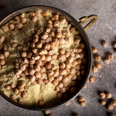 chickpea flour and chickpea kernels in the old metal bowl