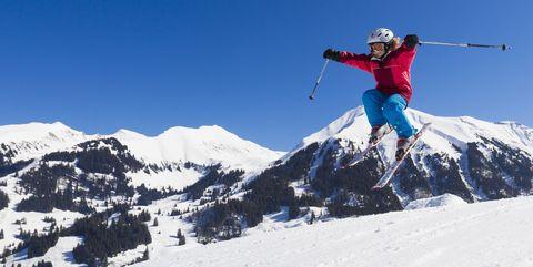 A child, a girl on skis jumping, Skiresort Wiriehorn, Diemtigtal valley, Bernese Oberland, Switzerland, Europe