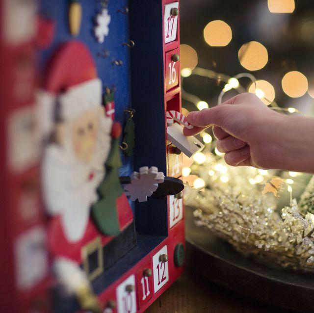 child opening christmas advent calendar
