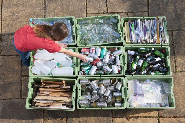 girl organising recycling bins