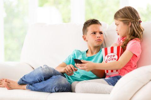 children fighting over the tv remote