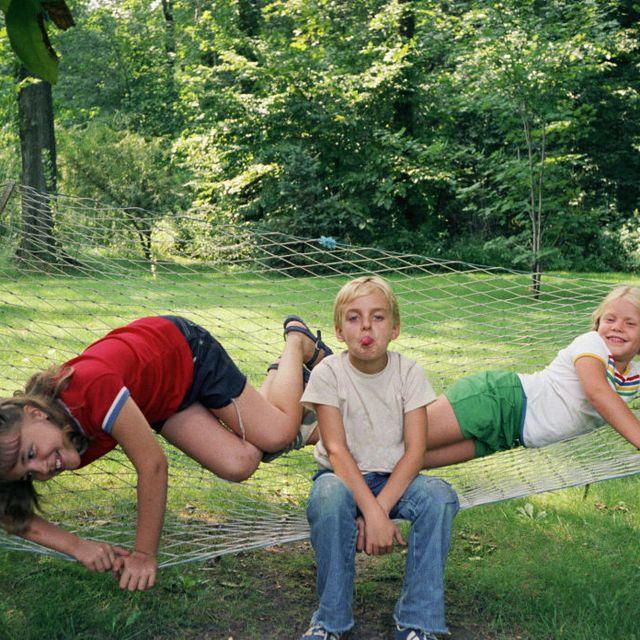 Children playing on hammock