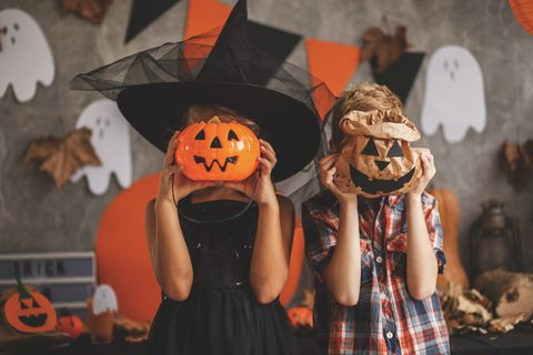 children playing with halloween decoration