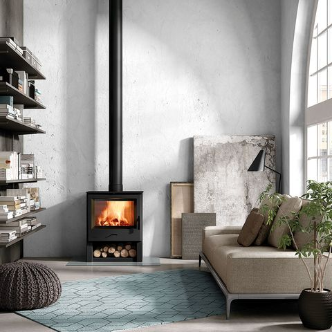 Wood-burning stove, Hearth, Living room, Fireplace, Room, Heat, Furniture, Interior design, Stove, Wall,