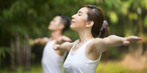 chinese man practicing tai chi outdoors