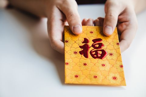 chinese new year celebration give or receiving red envelop