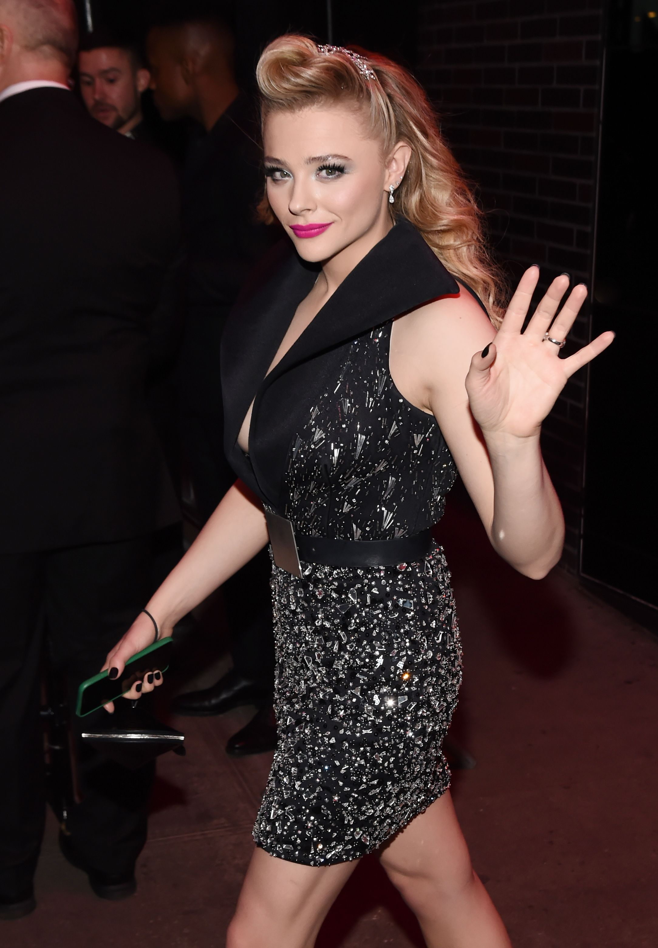 Chloe Grace Moretz Chloe Grace Moretz hit the streets in a black sleeveless blazer dress with a deep-v neckline.