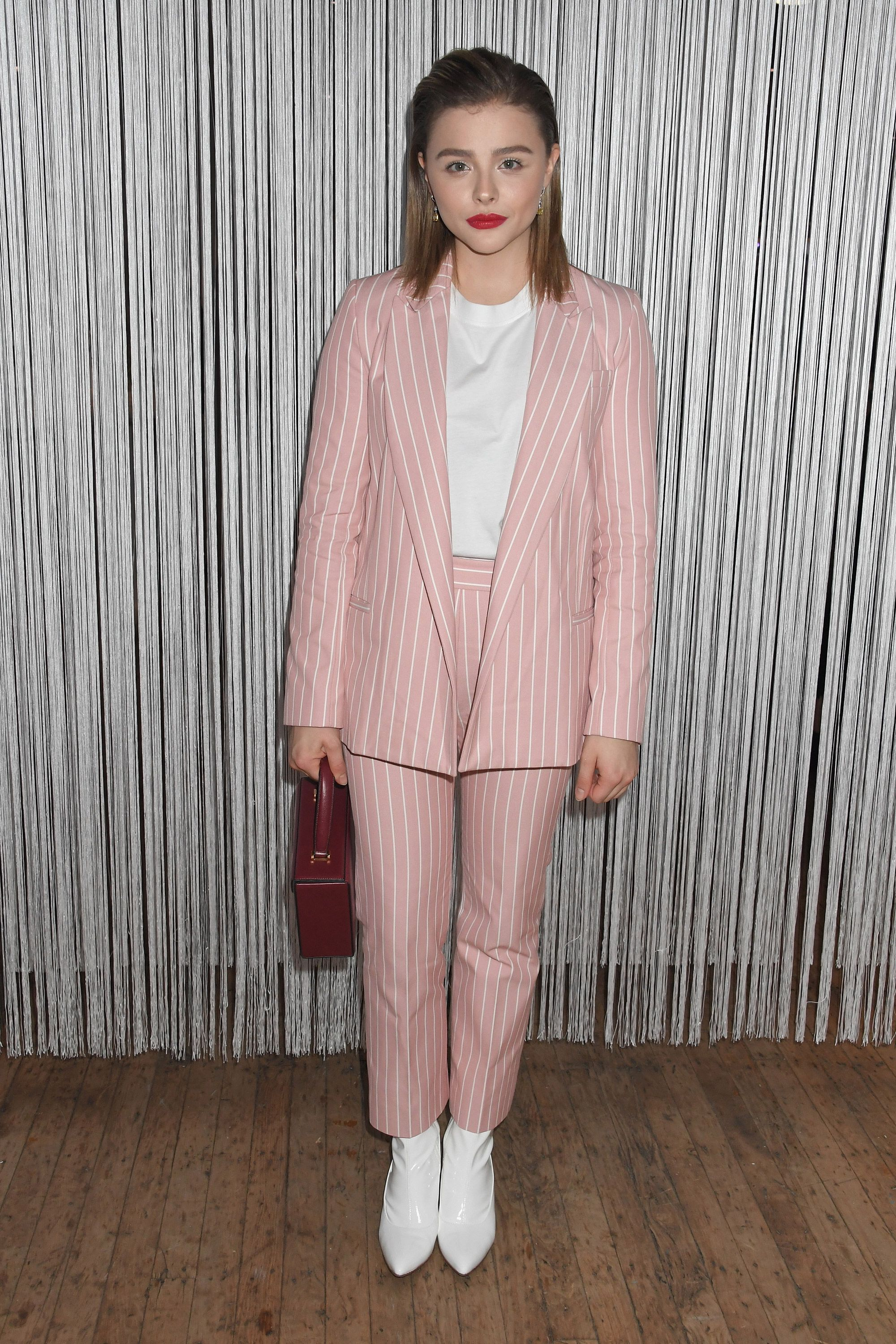 the subtle way chloë grace moretz's outfit shows she's trying to