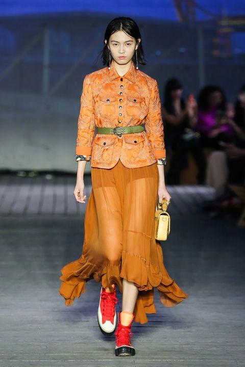 Fashion model, Fashion show, Fashion, Runway, Clothing, Orange, Fashion design, Footwear, Public event, Event,