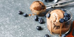 Chocolate ice cream with blueberries in glass cup