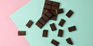 Chocolate pieces on color block background