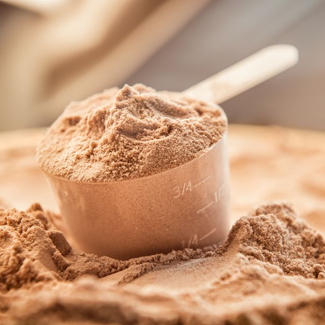 chocolate whey protein powder with a filled scoop
