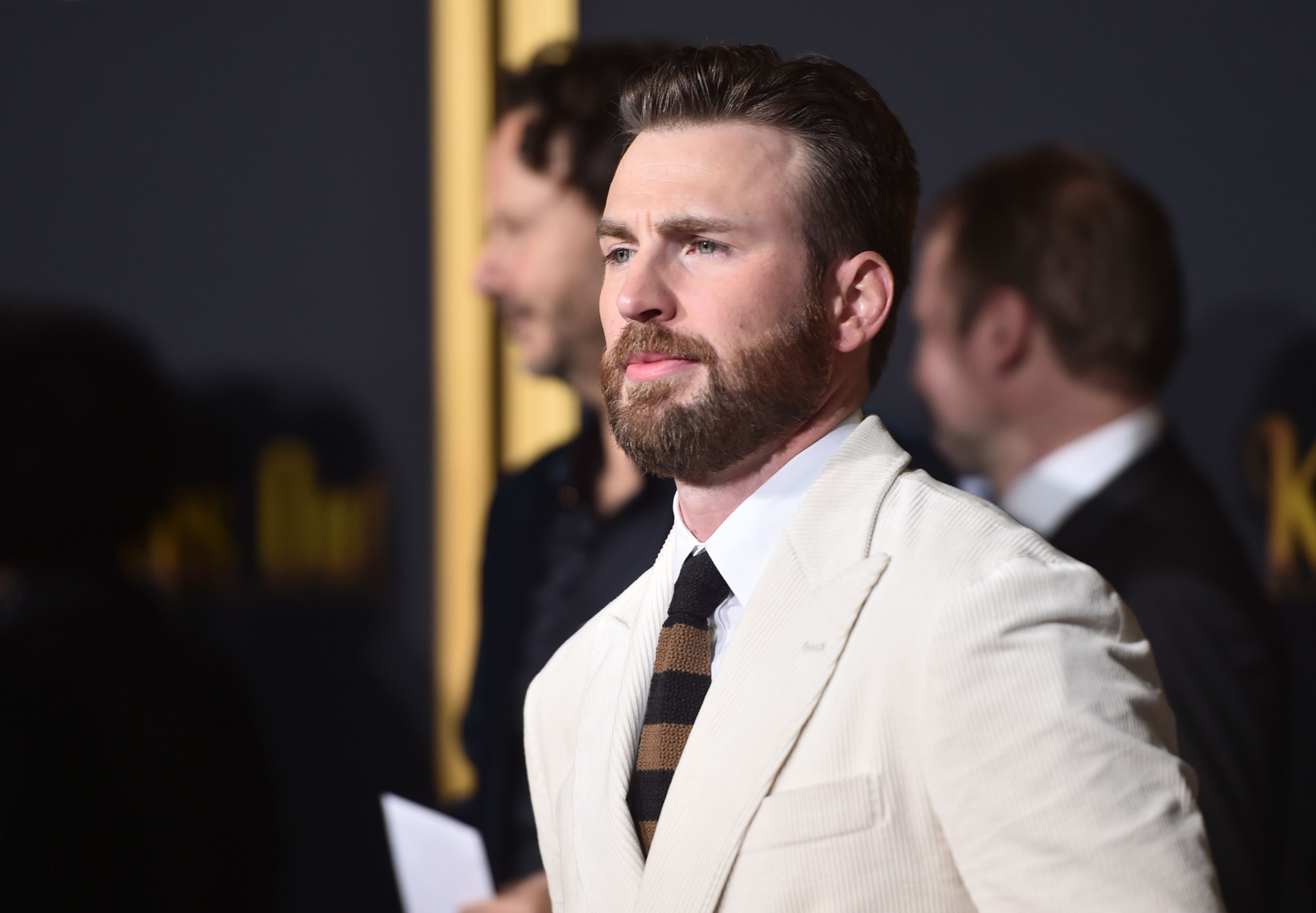 Chris Evans' Double-Breasted Winter-White Suit Is Giving Me So Many Conflicting Feelings