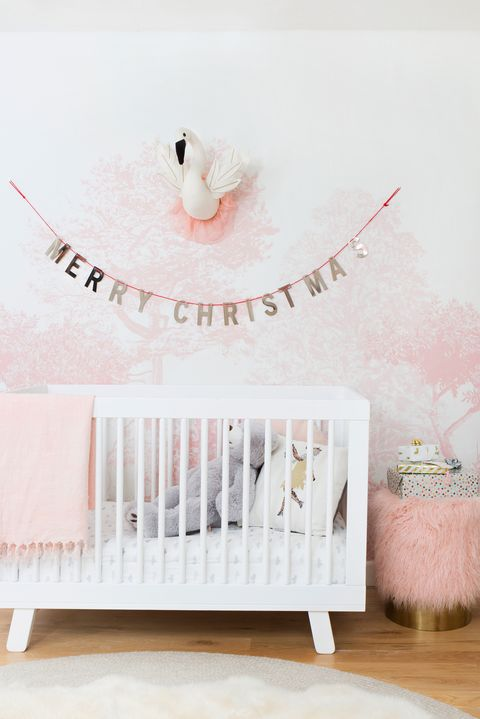 pink nursery with garland for holidays