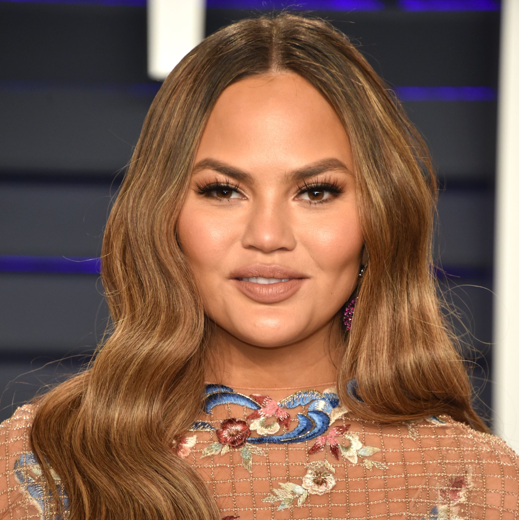 Chrissy Teigen Just Responded To A Troll About Her 'Unnatural' Cheeks In The Best Way