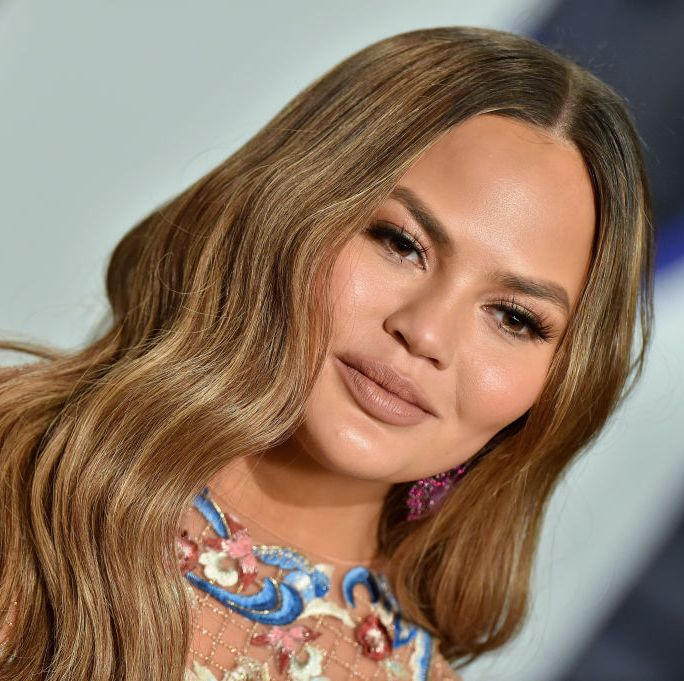 Chrissy Teigen just debuted a blunt bob and fringe and we are here for it