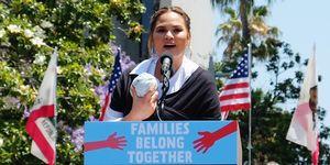 chrissy teigen speaks at the families belong together