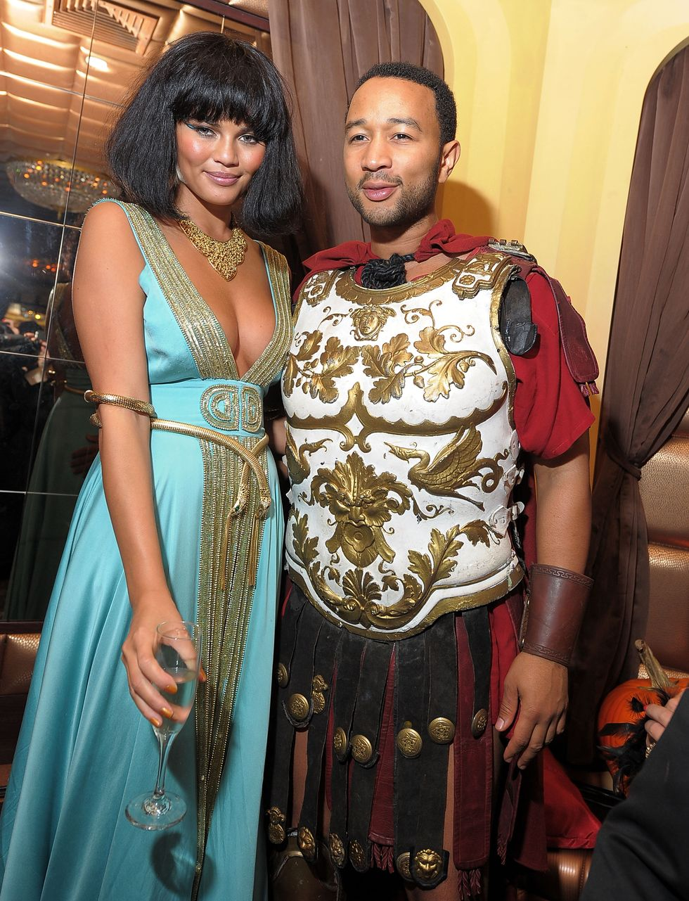Chrissy Teigen and John Legend - Antony and Cleopatra Model Christine Teigen and musician John Legend attended Heidi Klum's 2010 Halloween party in New York City dressed up as Antony and Cleopatra. I mean, check out that armor.