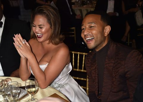 Chrissy Teigen and John Legend laughing at the Critics' Choice Awards