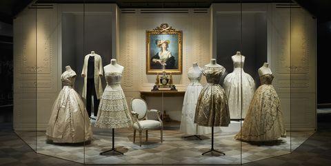 Fashion, Display window, Dress, Display case, Costume design, Tourist attraction, Photography, Scene, Museum, Window,