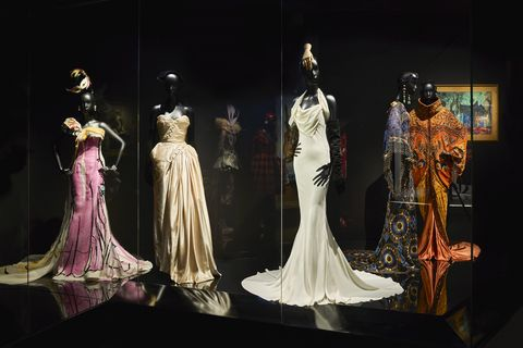 Fashion, Dress, Costume design, Figurine, Display case, Fashion design, Gown, Haute couture, Victorian fashion, Collection,