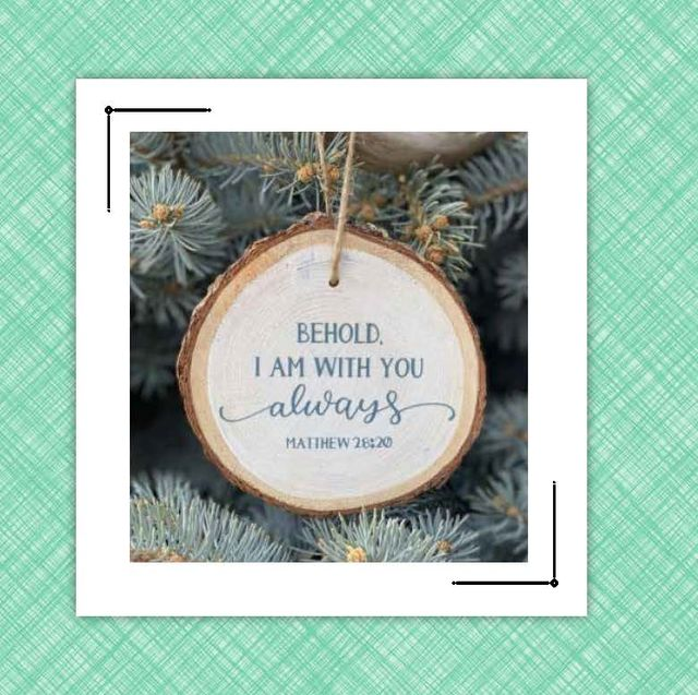 christmas ornament and cross necklace