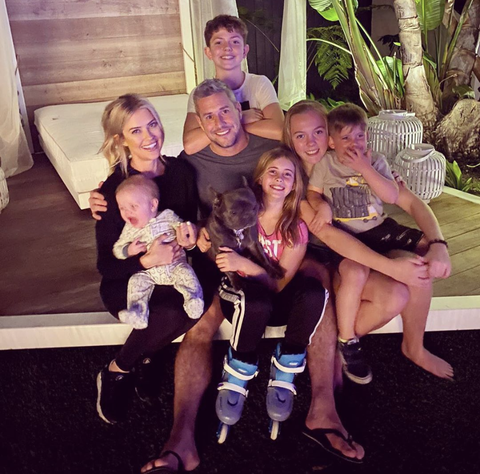 family photo of christina and ant anstead with their shared seven children and french bulldog