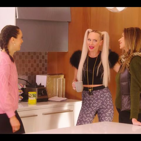 christine quinn, from netflix's selling sunset reality show, wears a black fluffy top and logo leggings