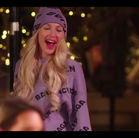 christine quinn, from netflix's selling sunset reality show, wears a lilac balenciaga logo jumper and beanie