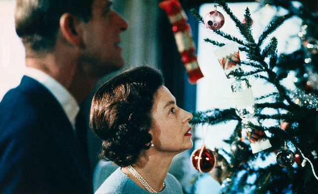 queen elizabeth and prince philip looking at christmas tree