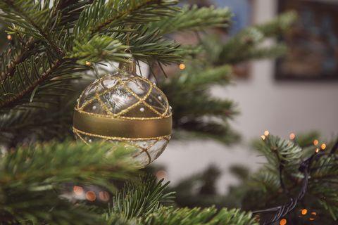 Christmas Bauble hanging on Christmas tree