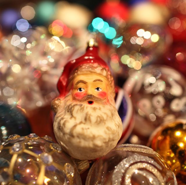 bearded santa claus decoration among vintage christmas tree glass baubles