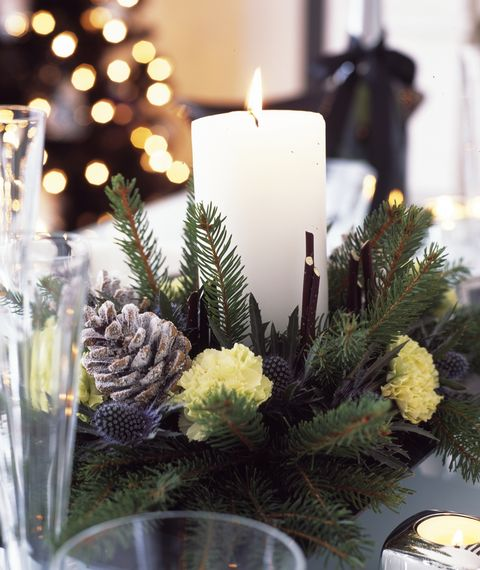 black and white christmas decorations with silver and forsted violet for home, dining table with candle centerpiece made with  fresh cut bough, pine cones and carnations