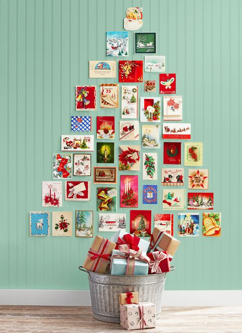 holiday cards arranged in the shape of a christmas tree and hung on the wall