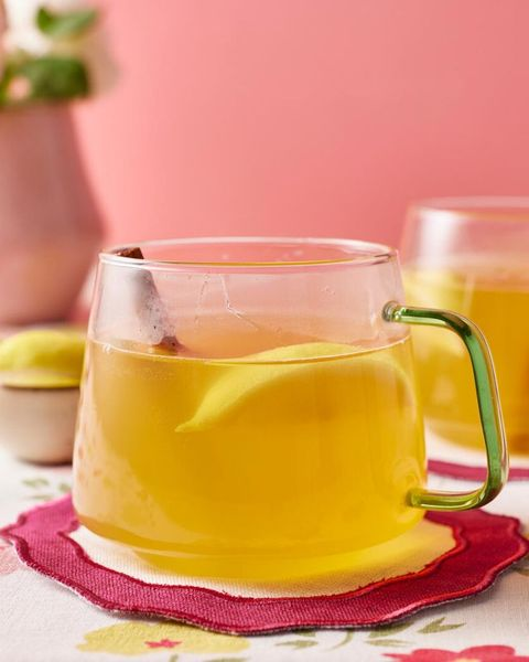 hot toddy with lemon wedge on red coaster