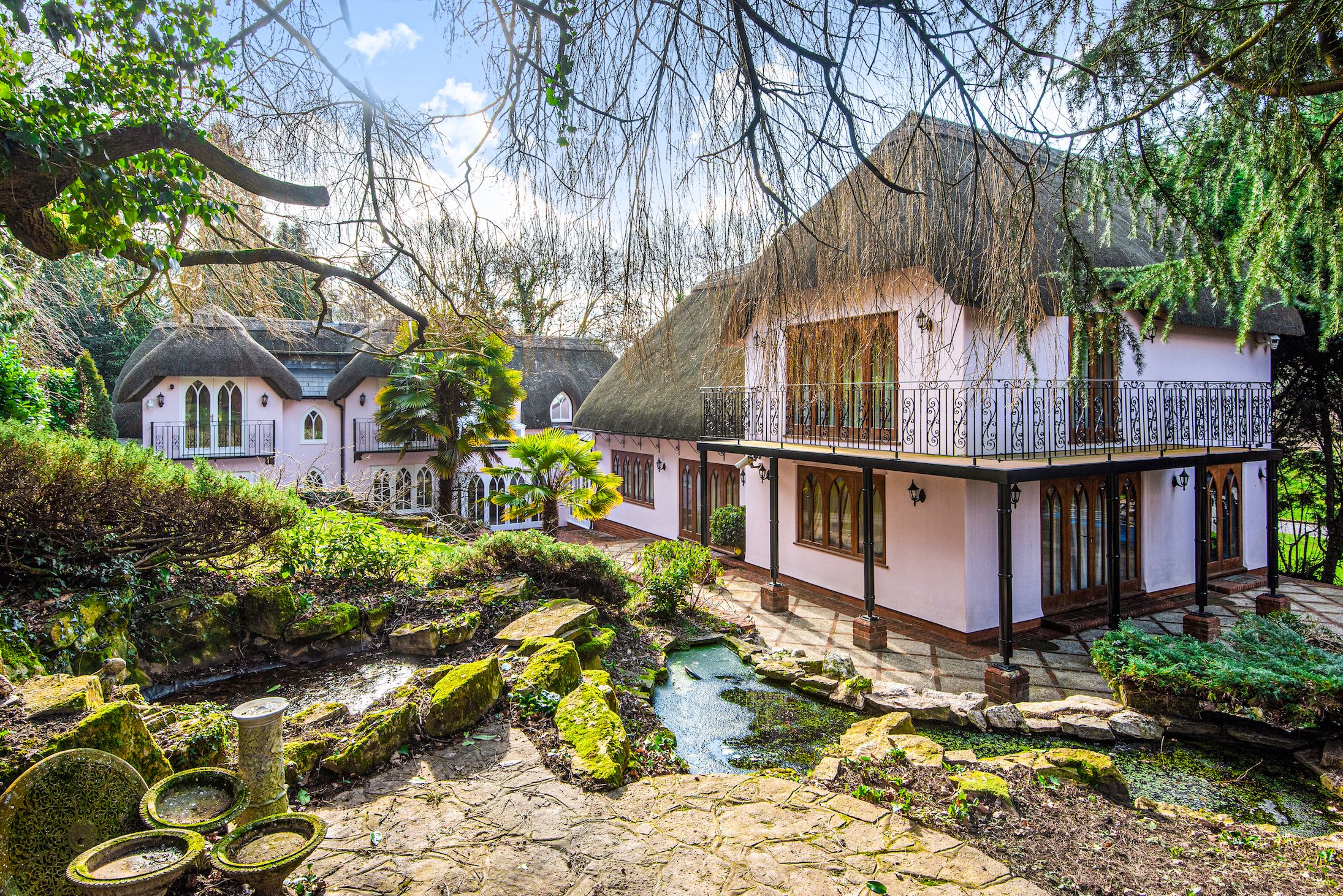 This enchanting pink period cottage for sale in Hampshire looks like it belongs in a fairy tale