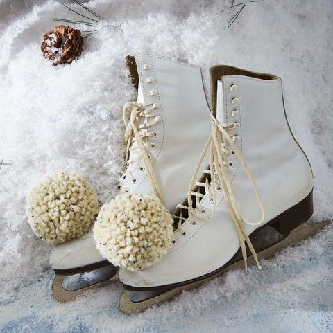 ice skates with pom poms