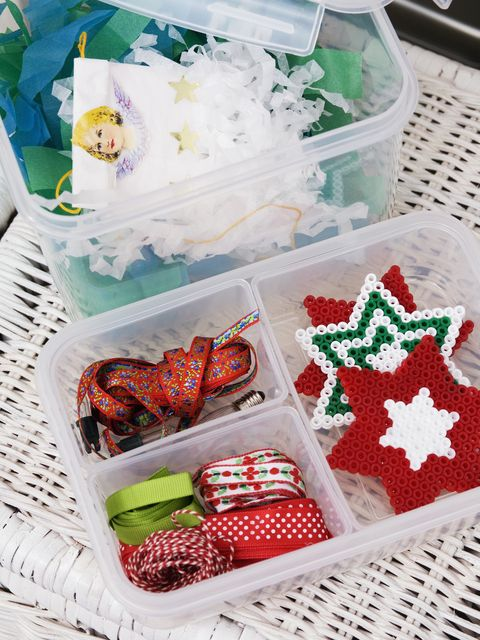 Christmas decorations and ribbons in box