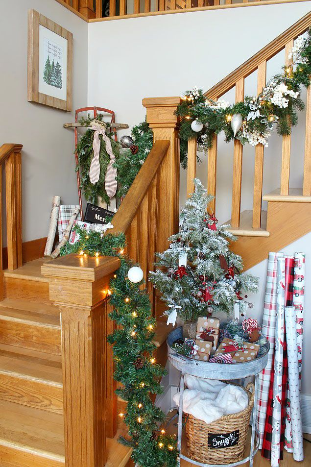 12 christmas decorations for stairs how to decorate a staircase indoors for christmas - Banister Christmas Decorations
