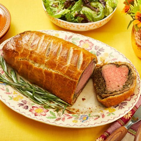 beef wellington on platter with rosemary