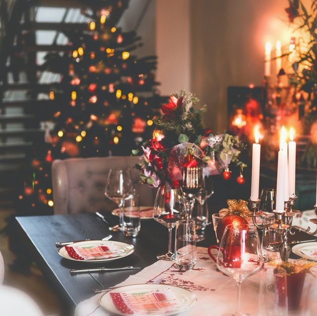 christmas dinner table at festive cozy room background with christmas tree