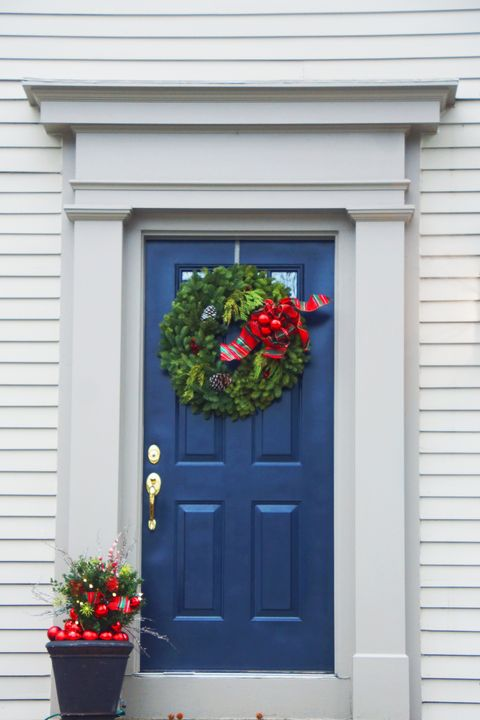 beautiful blue front door decorated for christmas