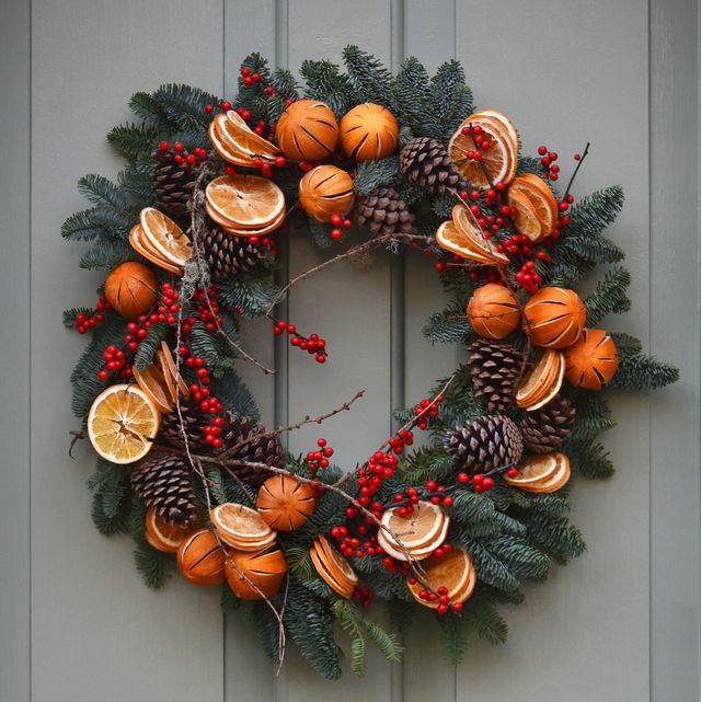 traditional decorative yule christmas wreath on a victorian front with period 19th century knocker and letter box door in london, uk