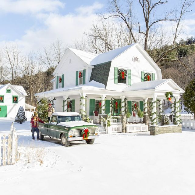 farmhouse project exterior in update new york white farmhouse with vintage truck, snow and christmas decorations
