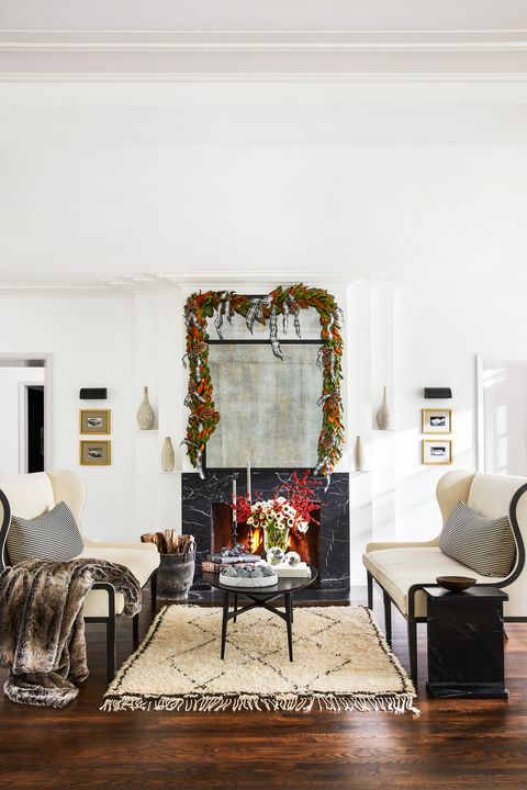living room with fireplace decorated for holidays