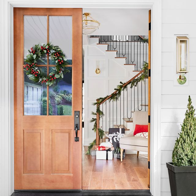 entryway of home decorated for christmas